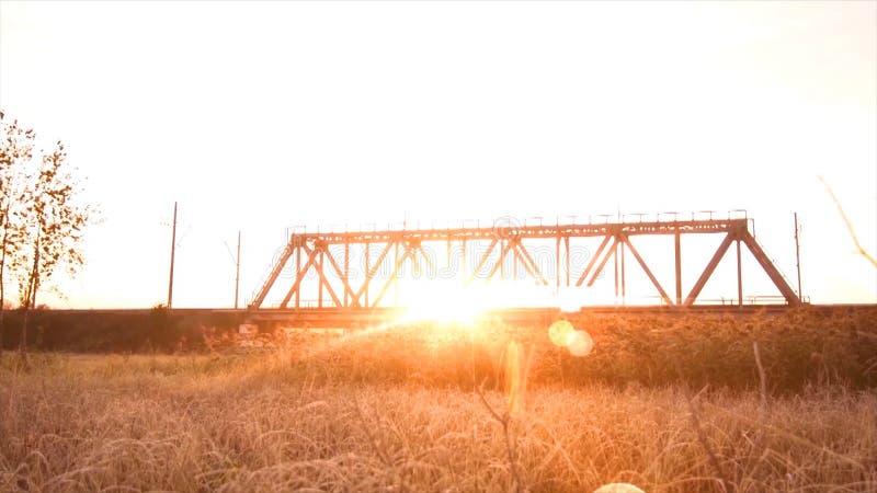 Bridge road. Train traffic transportation. Timelapse railway bridge on sunrise stock image