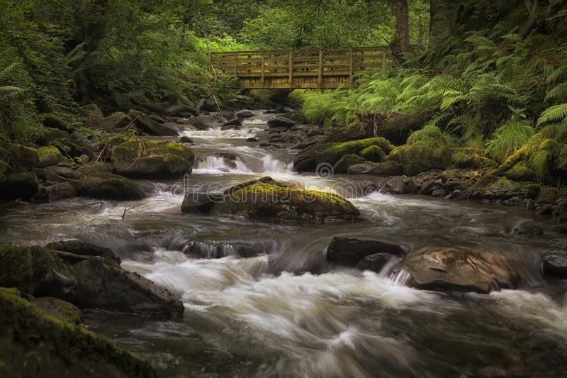 The bridge over the river Melin. The bridge and rocky river bed at Melincourt Brook in Resolven, South Wales, UK royalty free stock photography