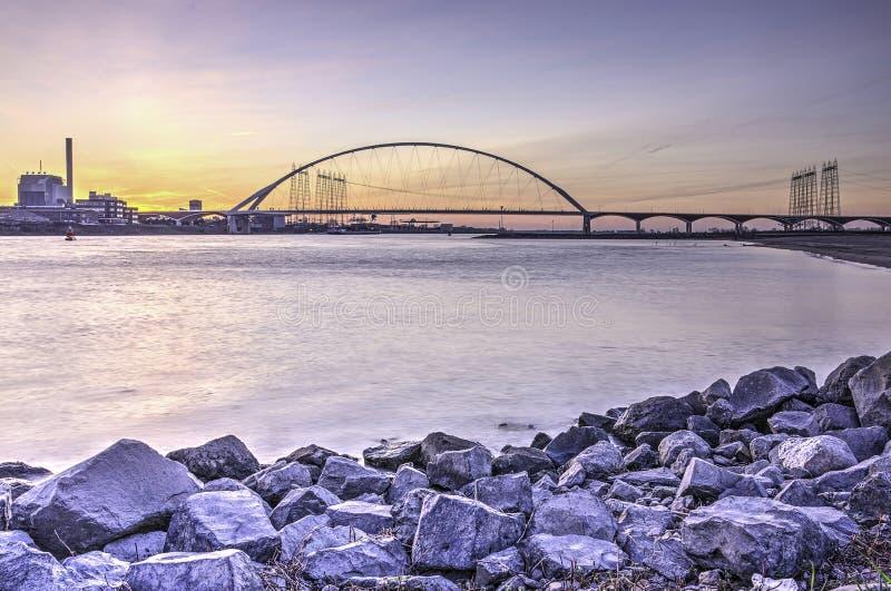 The bridge and the rocky shore stock photo