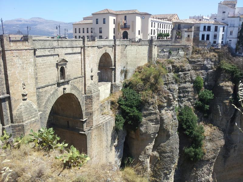 The bridge at Ronda in Spain. The hair-raising bridge over the gorge at Ronda in Spain. The bridge joins the two parts of the town stock photo
