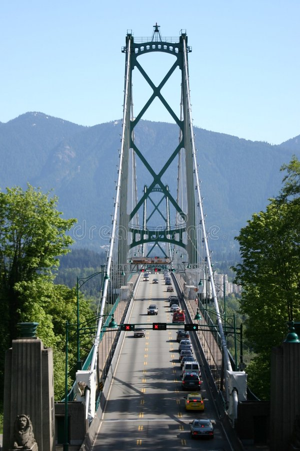 Bridge Scenic. A bridge in Vancouver Canada with mountains in the bakground royalty free stock images