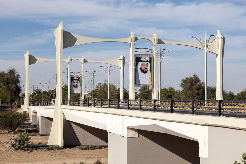 Bridge with sheikh portraits in Al Ain, UAE stock images