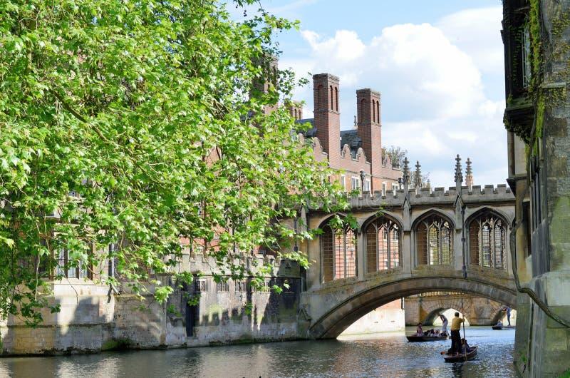 Bridge of Sighs over river Cam Cambridge England with punter. Cambridge England, United Kingdom -May 20, 2016: Bridge of Sighs over river Cam Cambridge England stock photo