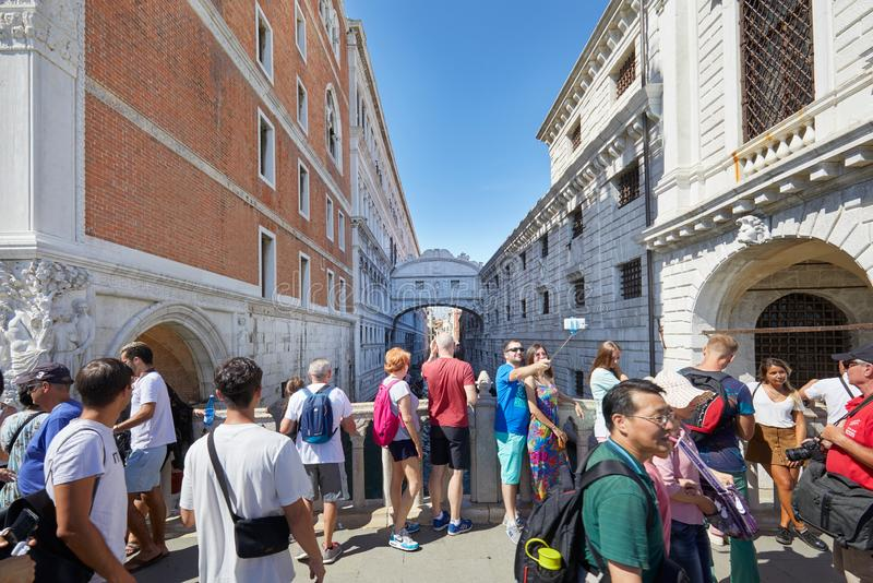 Bridge of Sighs people and tour tourists passing and shooting photos in Venice, Italy royalty free stock photos