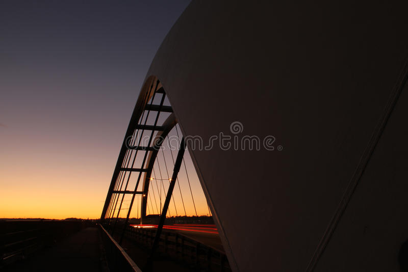 Bridge silhouette with colored sky. Silhouette of tall bridge with colored sky background concept of travel, exploration, space royalty free stock photography