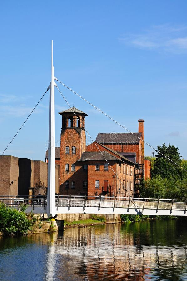 Bridge and Silk Mill, Derby. View along the River Derwent showing the Cathedral Green footbridge with the Silk Mill to the rear, Derby, Derbyshire, England, UK stock photo