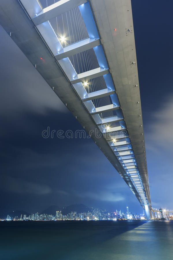 Bridge and skyline at night royalty free stock image