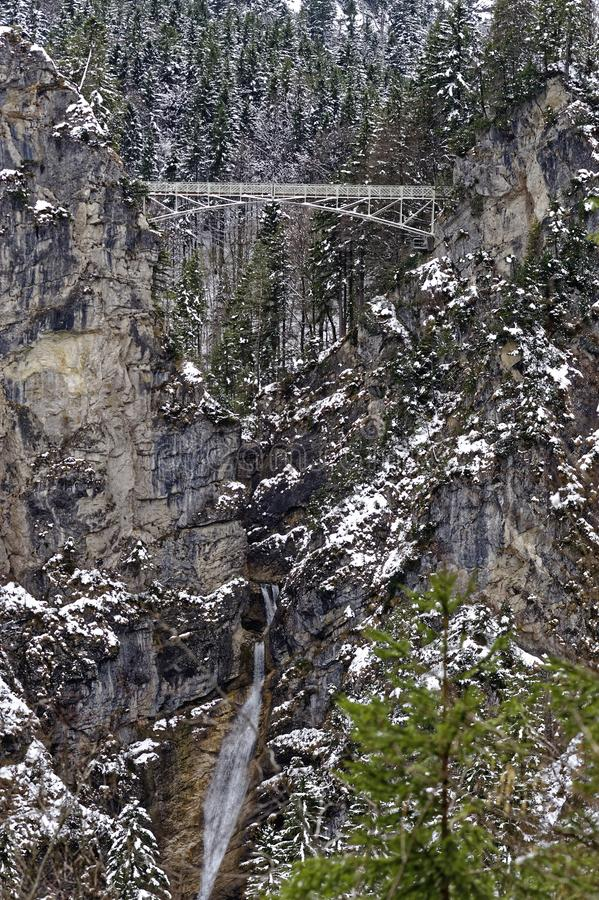 Bridge in snowy cliff background stock image