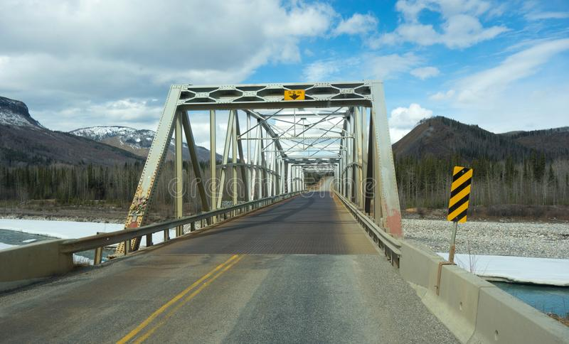 Driving along the alaska highway in the springtime royalty free stock image