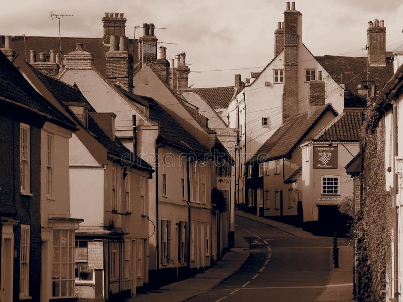 Bridge Street Bungay Suffolk United Kingdom. Colourful houses and shops Bridge Street Bungay Suffolk United Kingdom sepia vintage filter royalty free stock images
