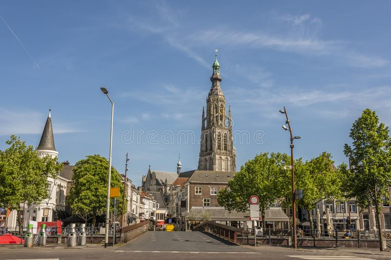 Bridge and street entrance to the city of breda holland netherlands. Bridge and main street entrance to the city of Breda. Stresses the tower of the great church royalty free stock images