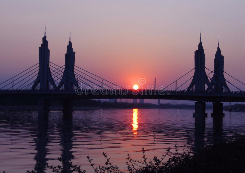 Download Bridge in sunset stock image. Image of dawn, river, blue - 30551467