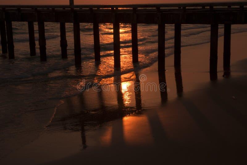 Bridge in sunset at Mae Ramphueng Beach. Rayong Province,Thailand royalty free stock image