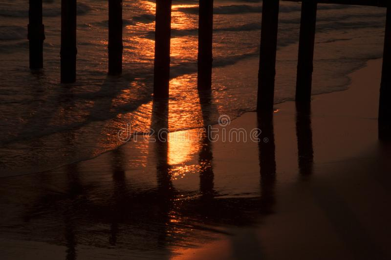 Bridge in sunset at Mae Ramphueng Beach. Rayong Province,Thailand stock images
