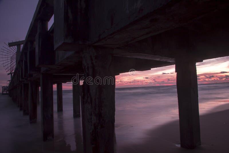 Bridge in sunset at Mae Ramphueng Beach. Rayong Province,Thailand royalty free stock photography