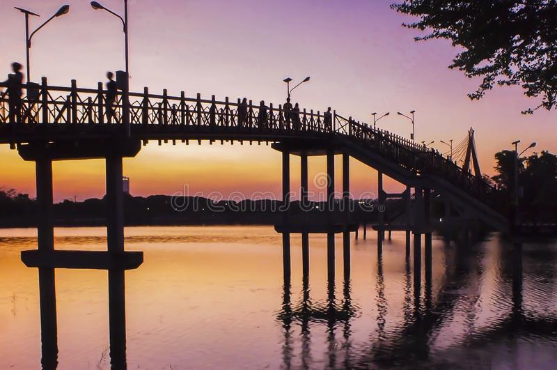 Bridge at sunset .Vanilla sky in blur and pink shade with crowd on the bridge . silhouette photography.  royalty free stock images