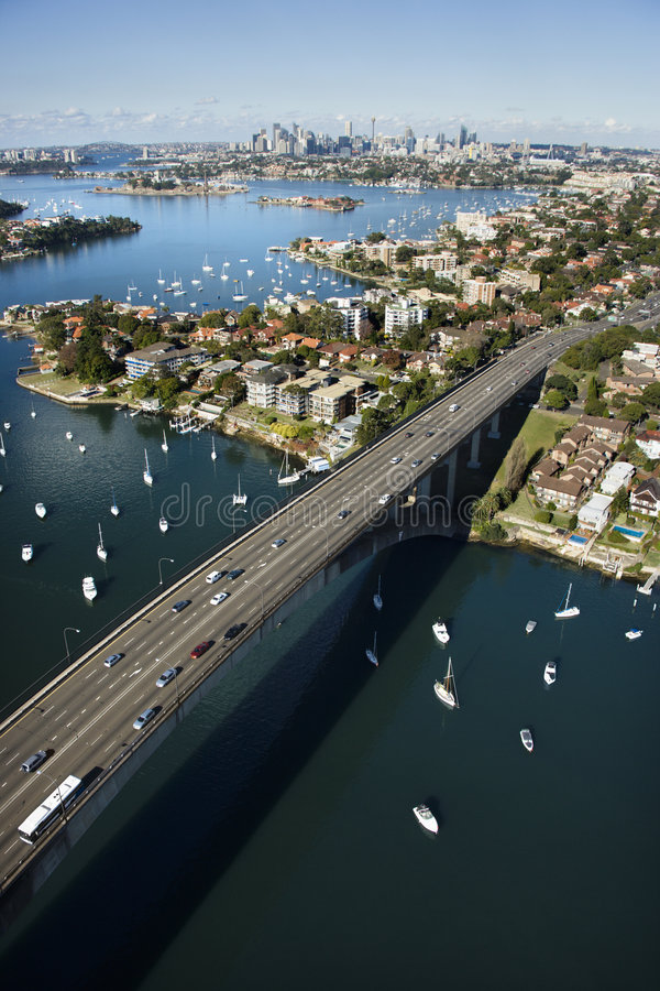 Bridge, Sydney, Australia. Aerial view of Victoria Road bridge and boats with distant downtown skyline in Sydney, Australia royalty free stock photography
