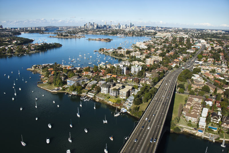 Bridge, Sydney, Australia. Aerial view of Victoria Road bridge and boats with distant downtown skyline in Sydney, Australia royalty free stock images