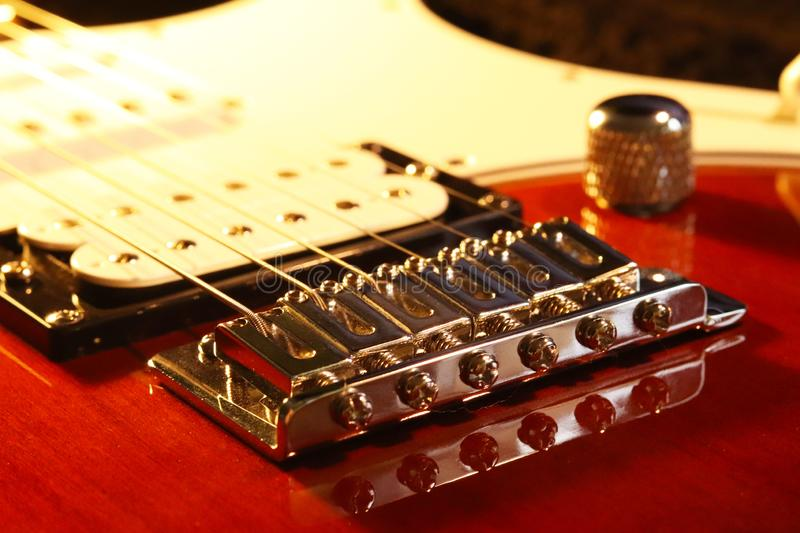 Bridge - Tailpiece and Humbucker Pickup Machine of an electric guitar stratocaster with pegs and strings. Artistic photo of a. The head of the neck of an stock image
