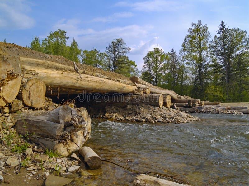 The Bridge through timber river royalty free stock image