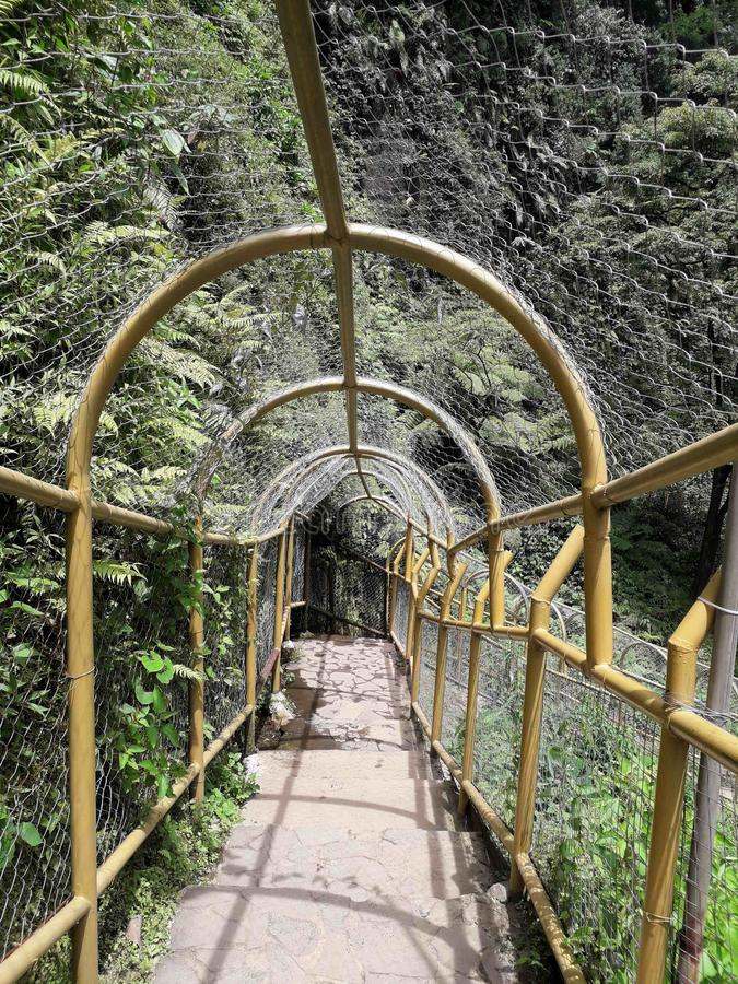 The bridge to Cimahi Waterfall. This picture was taken by me when I want to see the Cimahi Waterfall closely in Bandung, Indonesia stock photography