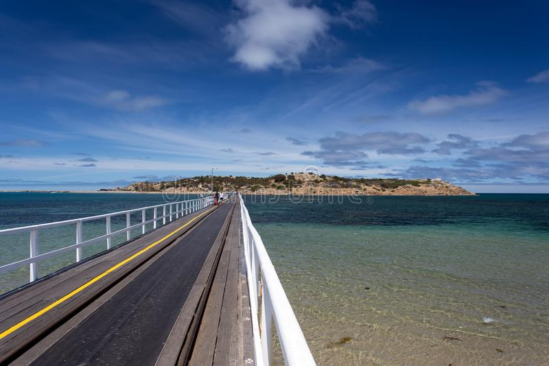 Bridge to Granite Island, South Australia. The bridge to Granite Island, where a horse-drawn carriage is operating to carry passenger to and fro the island stock photo