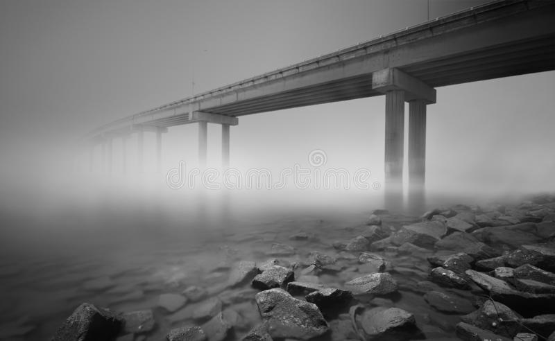 Bridge  to knowhere shot in black and white fine art photography using long exposure technique. royalty free stock images