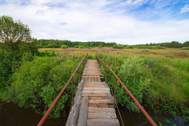 Bridge to nature: a midsummer landscape stock photos