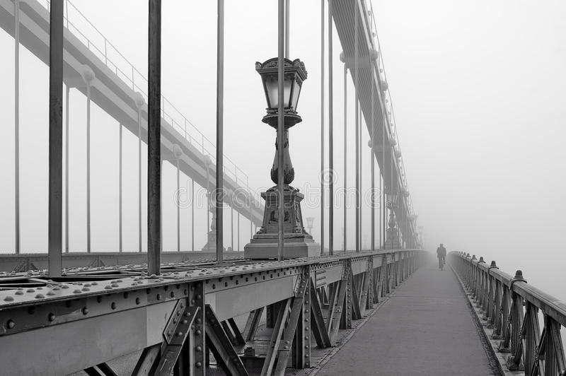 Bridge to nowhere. The Chain Bridge in a foggy morning. Budapest, Hungary