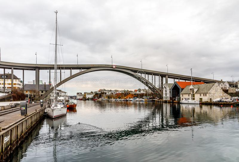 The Bridge to Risoya, sailboats in the canal in the city of Haugesund, Norway. Clouds, calm water, reflections on the surface stock photos