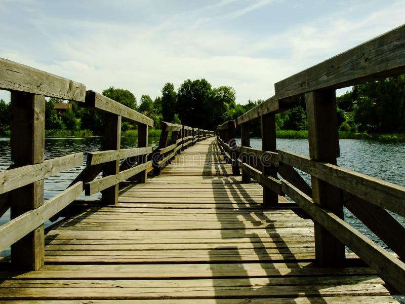 Bridge to Somewhere in Trakai. Bridge over the Lake in Trakai City near the Capital City of Lithuania royalty free stock images