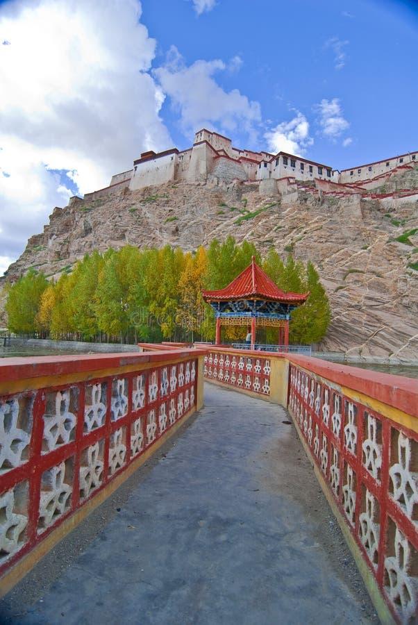 Bridge to Tibetan monastery stock image