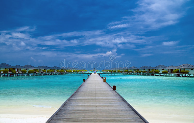 Bridge to water bungalows. In the indian ocean royalty free stock photography