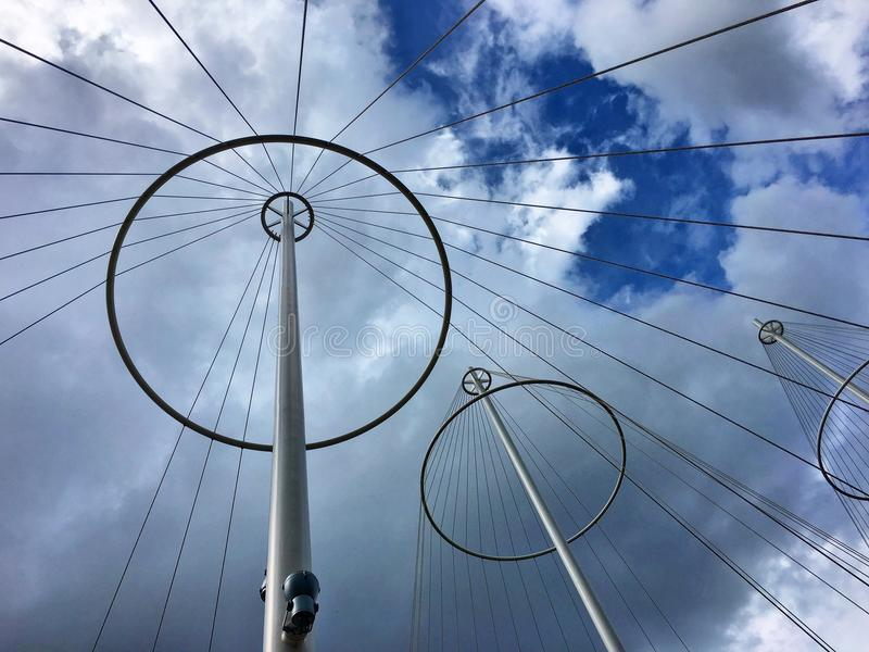 Bridge poles reaching into the sky royalty free stock photo