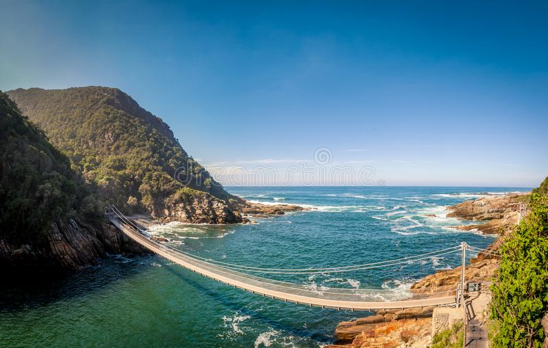Bridge - Tsitsikamma National Park - Storms River - South Africa. Bridge over canyon, over River Storm, near the ocean stock photos