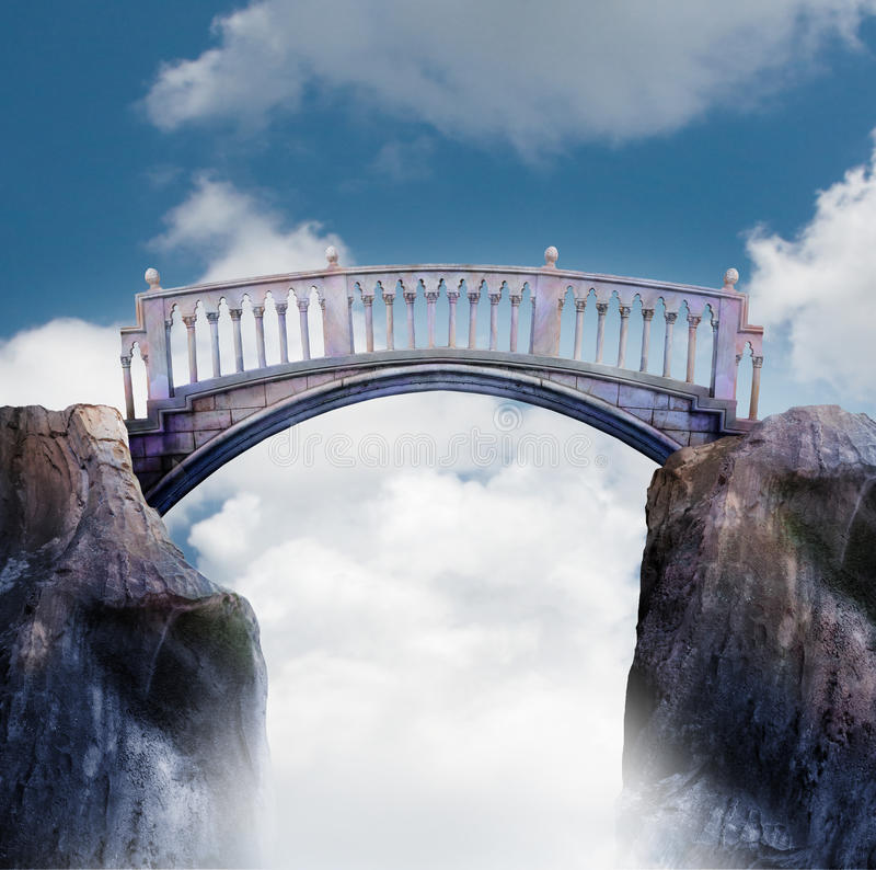 Bridge between two cliffs. A marble bridge spans between two cliffs high in the sky with a cloudy sky stock images