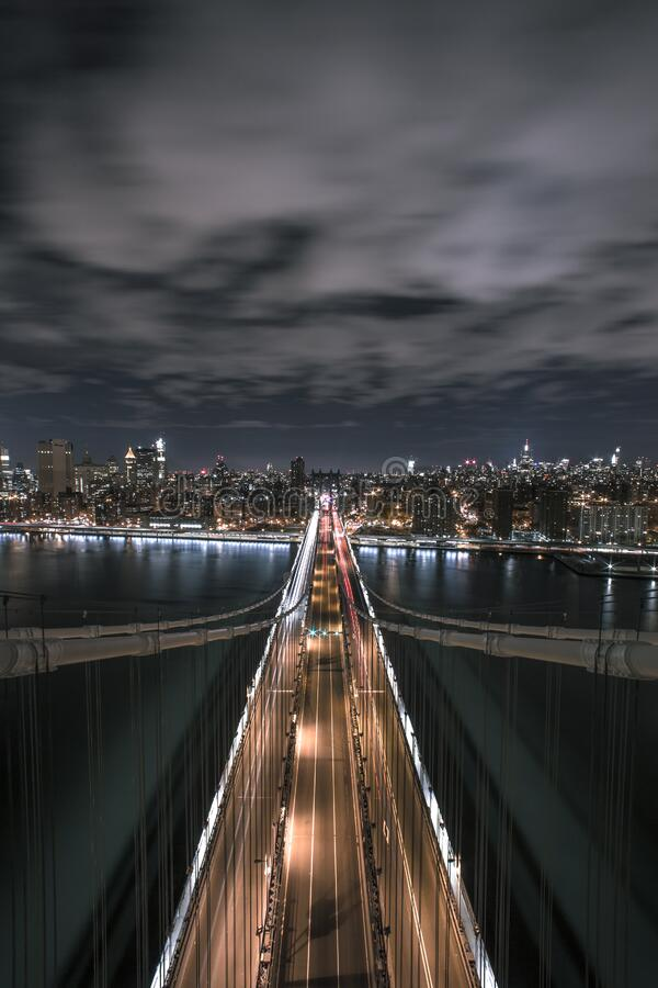 Bridge Under Grey Cloudy Ski during Night Time stock image
