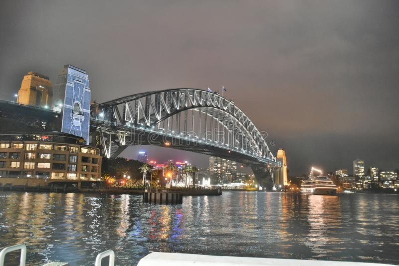 Bridge Under Grey Cloudy Sky During Nighttime stock images