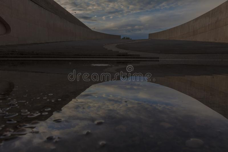 Bridge in Vroenhoven with a view on the amphitheater with natural reflections stock photography
