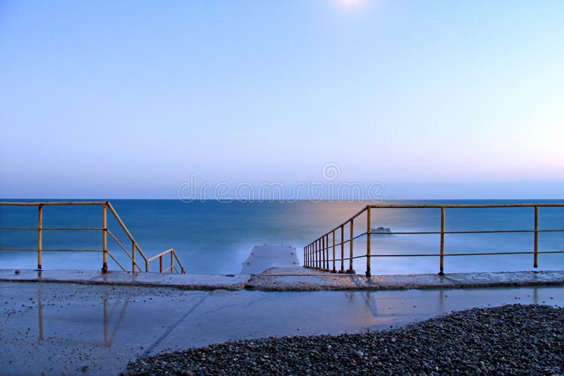the evening sea and moonlight royalty free stock image
