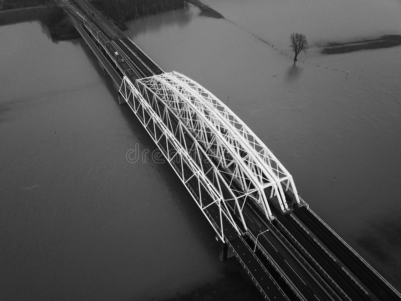 Bridge @ Westervoort. The bridge @ Westervoort the Netherlands with ``high water`` inside the river. Flooding the floodplains royalty free stock image