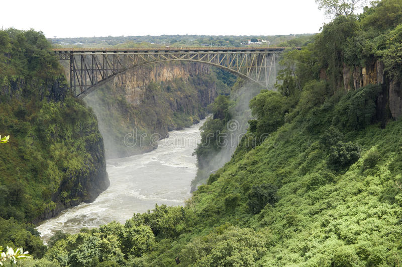 Bridge between Zambia and Zimbabwe. Africa. The water comes directly from the Victoria Falls royalty free stock photos