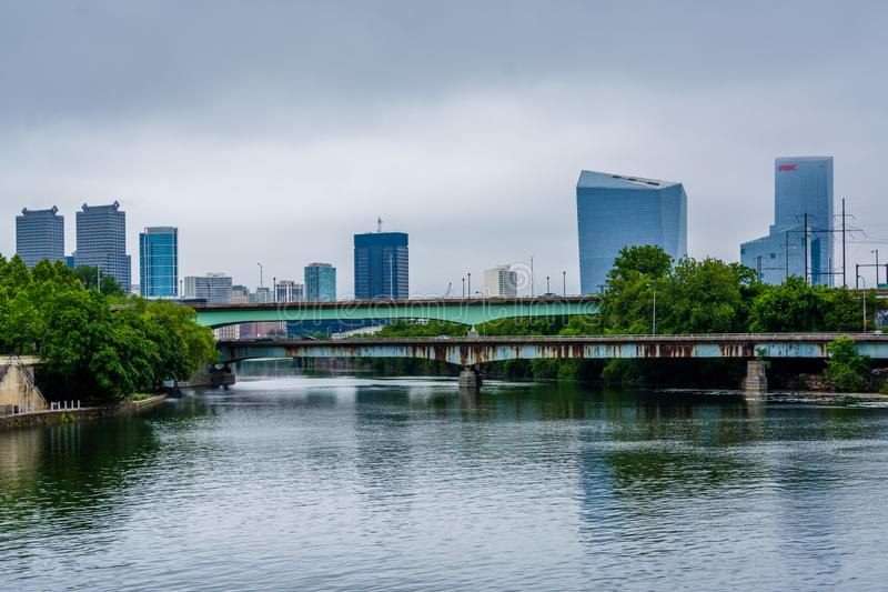 Bridges and buildings along the Schuylkill River in Philadelphia, Pennsylvania.  royalty free stock image