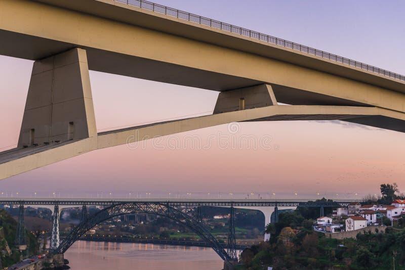 Bridges over Douro River. Prince Henry Bridge between cities of Porto and Vila Nova de Gaia, Portugal. Old and new railway bridges on background royalty free stock photography