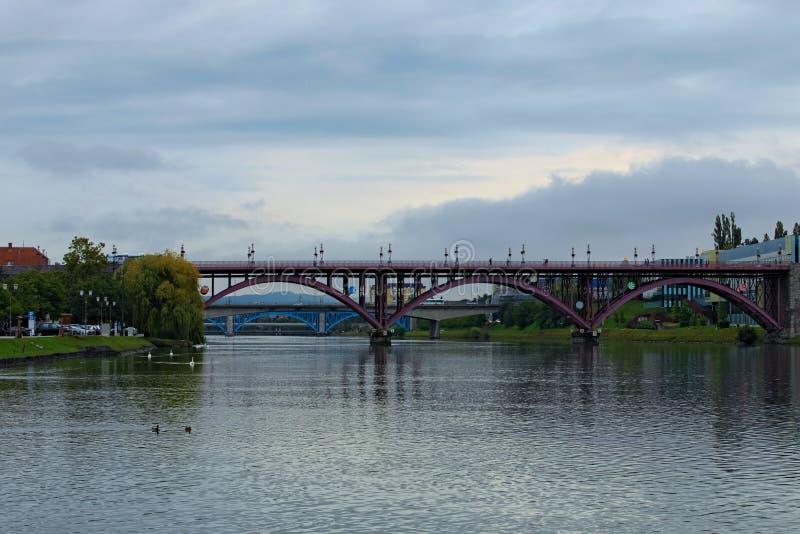 Bridges over Drava River in Maribor. Old Bridge, Titov bridge and Railway bridge. Scenic autumn landscape. Maribor, Slovenia stock image