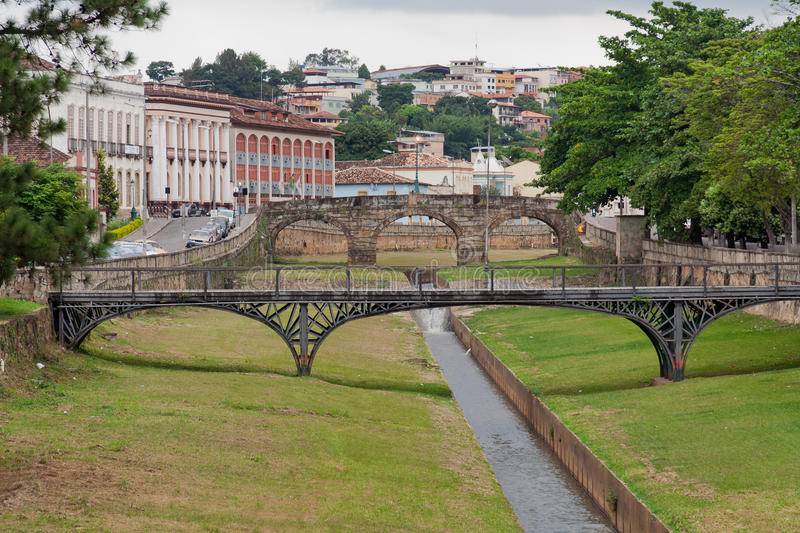 Bridges in Sao Joao del Rei Minas Gerais Brazil. An iron and a stone bridge over the river in downtown Sao Joao del Rei with its historical colonial buildings stock photos