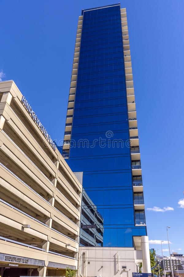 Bridgewater Place, Grand Rapids, Michigan. Clear blue sky reflected in mirrored walls of Bridgewater Place, Grand Rapids, Michigan royalty free stock image
