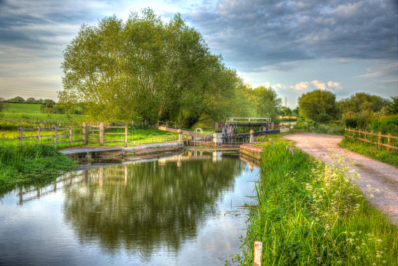 Bridgwater and Taunton Canal Somerset UK on calm still day in colourful HDR. Beautiful English canal and lock gate on calm still day in colourful HDR. Bridgwater royalty free stock photography