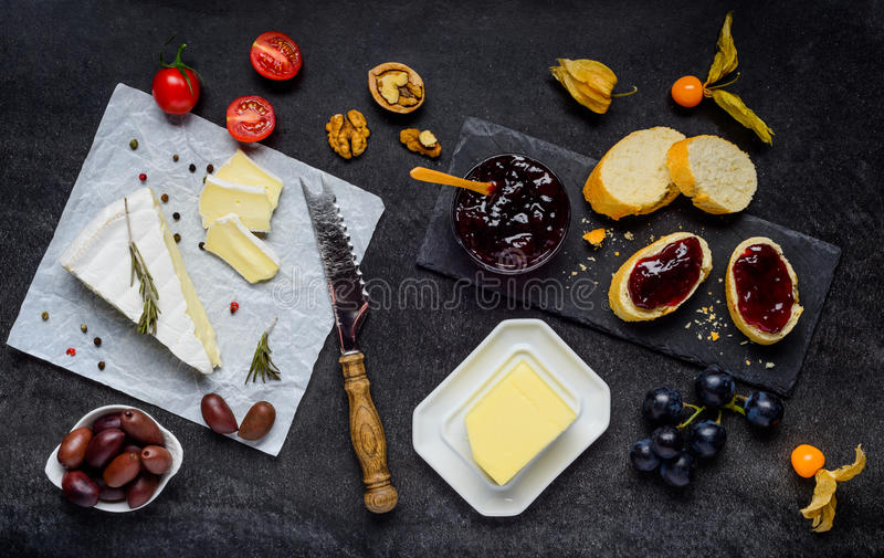 Brie Cheese with Jam, Bread and Butter royalty free stock photos