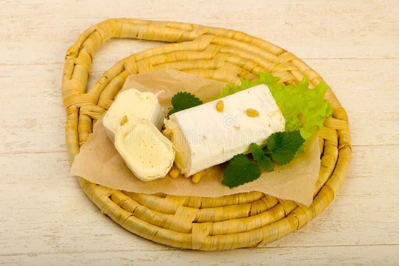 Brie cheese roll stock photo